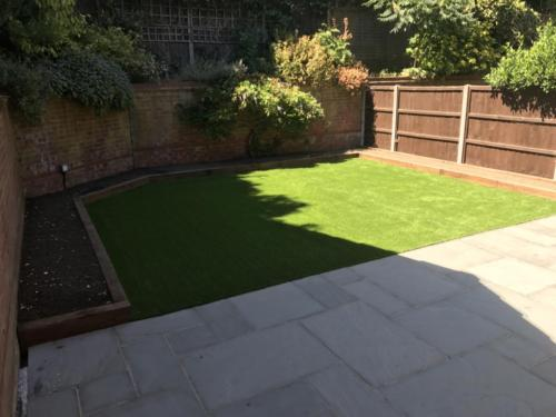 Artificial grass and sleeper installation