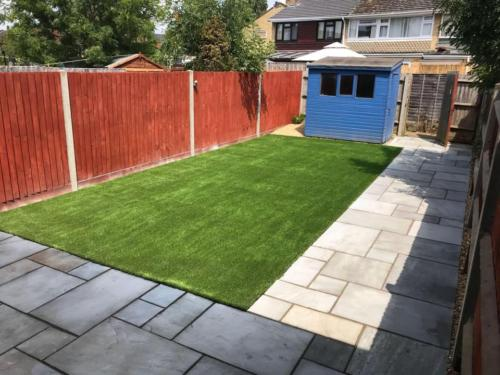 Artificial grass with shed
